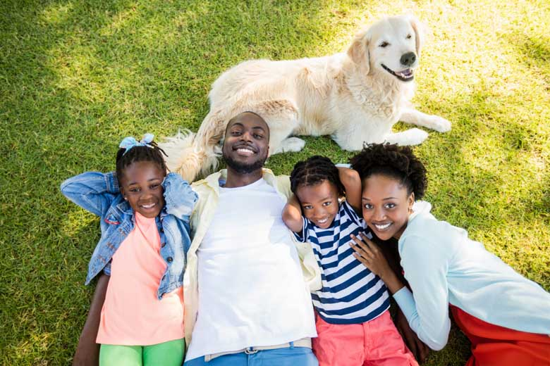 Family on lawn with dog